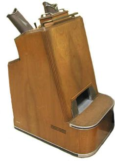 Shoe-Fitting Fluoroscope used in the 1930s, 40s and 50s.  Used in shoe stores -- essentially exposing people to unnecessary radiation.  What were they thinking?