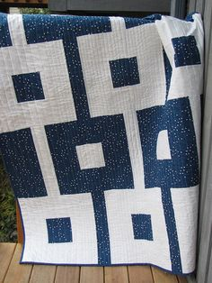 "The tiny blue dots on the navy here really shine in this ""Chain Gang"" quilt by Debbie Jeske of A Quilter's Table."