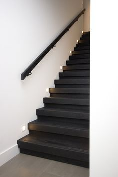 Theme of stairs is different from floor Painted Staircases, Staircase Handrail, Stair Railing Design, Painted Stairs, Wooden Stairs, Door Design, House Design, Black Stairs, Stair Lighting