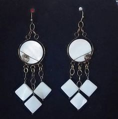 Check out this item in my Etsy shop https://www.etsy.com/listing/532164422/wire-wrapped-mother-of-pearl-earrings