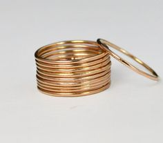 """Thin Round 14k Rose Gold Filled Stacking Ring: Dainty, rustic, and original. Each ring is different as I leave the solder joint untouched adding texture, occasional """"dew drops"""" of rose gold, and other"""
