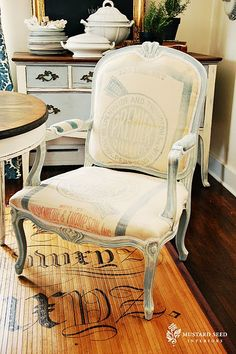 French chair and love the rug (haven't checked but looks like Miss Mustard Seed)