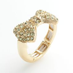 LC Lauren Conrad Gold Tone Simulated Crystal Bow Stretch Ring ($12) ❤ liked on Polyvore
