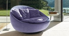 LACOON - Not just a big swivel armchair but a cozy nest where to indulge in fluffy pillows and wrapping. special mentionYOUNG 2009