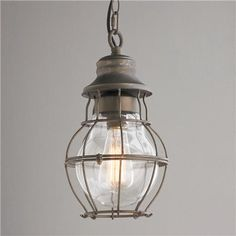 Metal Cage and Closed Glass Pendant With the vintage styling of an antique lantern, this contoured metal cage over glass has a modern industrial tone perfect for a kitchen or utility room. -or outside patio #BeachHouseCoastalDecor