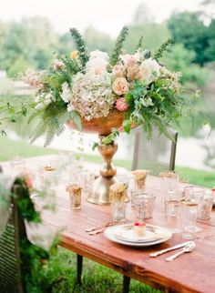 This centerpiece looks like it's from a fairy tale: http://www.stylemepretty.com/tennessee-weddings/2014/10/21/enchanted-southern-summer-wedding-inspiration/ | Photography: Ashley Upchurch - http://ashleyupchurchphotography.com/