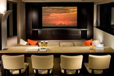 Home theater - love the cozy seating up front, and the stools at the snacking area across the back!