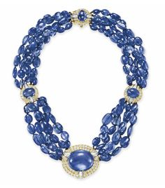 A SAPPHIRE AND DIAMOND NECKLACE, BY DAVID WEBB  Set at the front with a double oval cabochon sapphire, weighing approximately 80.77 carats, within a circular and baguette-cut diamond two-tiered surround, to the five-strand sapphire bead neckchain, intersected by two plaques and joined by a clasp of similar design, mounted in platinum and 18k gold