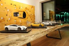 Individual models in acrylic display cases can be used to dramatic effect on a tabletop. These bespoke Lotus models were on display at an industry event.