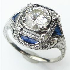 The Blue Arabesque: A grand statement of a ring, with a shimmering diamond floating like a mirage in a sea of blue.  Ca.1925. Maloys.com