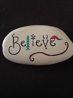**i would add a hanging ornament to the B.** Complete with a Christmas Tree, Reindeer, Snowflake, and Santa Hat, this beautiful inspirational Believe hand painted river rock is magically whimsical ! Measures: 5 x 3 x Christmas Pebble Art, Christmas Tree Painting, Christmas Rock, Painted Christmas Tree, Christmas Tree Design, Christmas Trees, Painted River Rocks, Hand Painted Rocks, Painted Stones