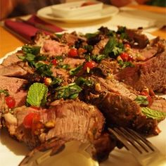 "Stuffed Leg of Lamb with Balsamic-Fig-Basil Sauce I ""Figs and balsamic vinegar give this recipe instant crowd appeal. The aged balsamic vinegar that we bought blends beautifully with figs in this recipe -- savory but sweet -- and combines beautifully with the fresh mint and the succulent lamb. A winner in my family!!"""