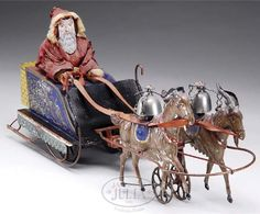 """Santa - The Althof Bergmann Santa in a Sleigh with Goats, which sold at auction for 161,000 USD. Is """"the rarest and most important of all Early-American tin toys and the Acme of  Clockwork American tin toys""""."""