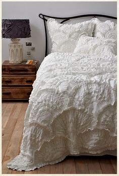 Anthropologie bedding.. LOVE. I want a white bed set so badly.