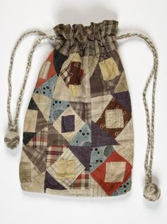 A beautifully faded patchwork of fabrics make this drawstring bag a joy to behold Patchwork Bags, Folk Costume, Sewing Projects, Sewing Ideas, Small Bags, Drawstring Backpack, Bucket Bag, Crafty, Embroidery