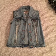 Button- up Denim Vest Size Small ****Final price reduction! Purchased this vest for $39.99 and wore it one time so this price is a major steal!****    Button-up denim vest in excellent condition. Made of strong denim and is super cute with dresses, short sleeves, tank tops, and long sleeves! Hot Kiss Tops