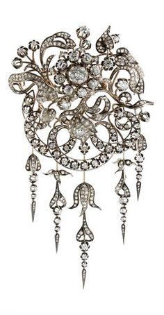 An antique silver, gold and diamond brooch, circa 1900.