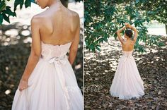 Strapless summer wedding dress. Lace bodice features sweetheart neckline and tie on back, long skirt accented with pleated detail.