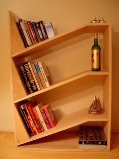 A design that enhances the utility of the ordinary bookshelf by not requiring bookends or heavy-handed adjustments when a book is removed from the stack.