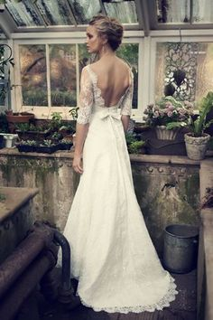 Lovely romantic cream wedding dress. Half lacy transparent sleeves with low-cut neckline on the back really sexy femme fatale. Wedding dress inspiration for brides to be <3