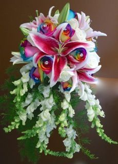 Cascade bouquet with starfighter lilies, rainbow roses, roses and snapdragons