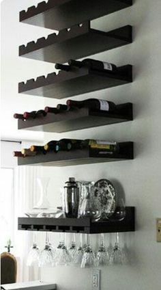 Dramatic DIY Kitchen Makeover After: Bar Wall Storage After: Bar Wall Storage With repainted lower cabinets, the bar area was well on its way to looking better. Lauren fastened wine racks to the wall for a space-savvy way to store wine and crystal gla Shelves, Wall Storage, Creative Furniture, Basement Bar Designs, Kitchen Diy Makeover, Kitchen Furniture Design, Kitchen Storage Shelves, Wall Bar, Furniture Makeover