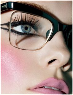 Glasses with gorgeous make up.