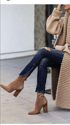 Alexander Wang boots styled with dark denim and a camel sweater for fall