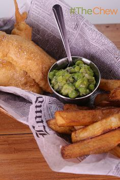 You don't need to head down to the local pub to fry up this English comfort food. Try out Michael Symon's Beer Battered Fish 'n' Chips with Mushy Peas on your family tonight! The Chew Recipes, Pea Recipes, Fish Recipes, Seafood Recipes, Cooking Recipes, Recipies, Beer Battered Fish, Mushy Peas, Epcot Food