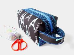 Zippered boxy pouch/make-up/cosmetic pouch with handle, with Eiffel Towers in blue and white on a black background and dark blue accents