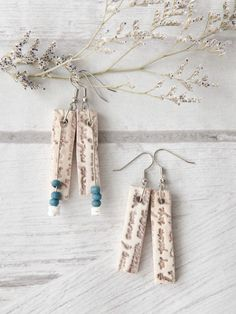 Brooke Bock created these faux bone earrings with polymer clay, using acrylic paint to create a distressed look. | Jewelry Affaire Autumn 2015