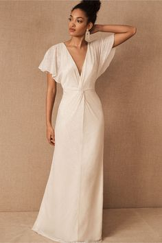 Romantic flutter sleeves and a graceful twist front lend elegant detail to this maxi dress, finished with a metallic shimmer.Only available at BHLDN Wedding Dress Over 40, Second Wedding Dresses, Wrap Wedding Dress, Reception Dresses, Wrap Dress, Bridal Gowns, Wedding Gowns, Champagne Bridesmaid Dresses, Sheath Wedding Gown