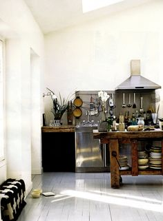 Asian inspired earthy restaurant style kitchen wood kitchen hood