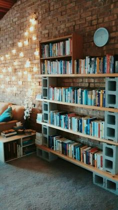 DIY cilinderblock bookshelves. Painted wood blocks or stone bricks (without holes) would probably look better.
