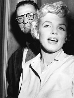 Marilyn Monroe and Arthur Miller at Sutton Place during a press conference to announce their plans to wed, June 22, 1956.