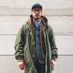 How to wear: olive parka, olive quilted gilet, navy denim jacket, light blue long sleeve shirt Military Fashion, Mens Fashion, Look Man, Blue Long Sleeve Shirt, Wearing Black, Adidas Men, Men Casual, Menswear, How To Wear
