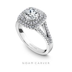 This dazzling double halo is a bestseller for a reason.  Round cut, double halo Noam Carver engagement ring