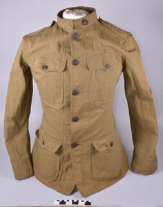 Olive Drab World War I uniform of Pvt. William F. Eydmann, a draftsman from St. Louis who joined the army in 1918 and served overseas with the Motor Transport Corps from September 1918 to July 1919. This is a Model 1912 jacket and pants, indicated by the way the buttons are attached to the jacket. | Missouri History Museum #militaryhistory #WWI