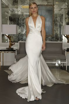 Romona Keveza goes sexy and glamorous for Fall 2015 with this deep V-neck wedding gown. {Photo: Dan Lecca}