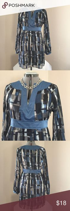 """🆕Listing: BCBG Blue Graphic Dress BCBG Blue Graphic Dress. Size L measures: 10"""" across neck, 20"""" across chest, 16.5"""" across at blue band, 22"""" across hips, 27"""" sleeve from neck. Sleeves are raglan cut and are sheer, see pic 5. Side zip close. Fully lined. 100% poly, machine washable. 305/25/032317 BCBG Dresses"""
