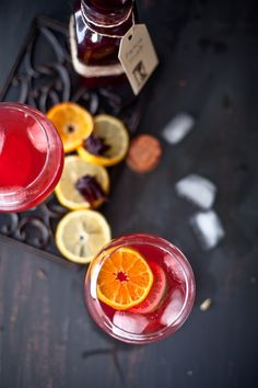 Vodka with hibiscus syrup and citrus.  http://www.annabelchaffer.com/categories/Dining-Accessories/