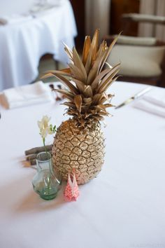 DIY spray painted pineapple centerpiece with origami bunny