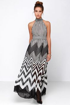 Hey hey hey! We know you want the Blurred Lines Black and Ivory Striped Maxi Dress! Woven black and ivory stripes hang out horizontally on a high neckline that wraps around and ties above a sexy back cutout, while vertical stripes take over on the bodice and banded waist. A full, maxi length skirt sweeps towards the floor with varying gradients of chevron stripes that are sure to strike your fancy. Hidden back zipper/hook clasp. Lined to mid thigh. 100% Polyester. Hand Wash Cold. Imported.