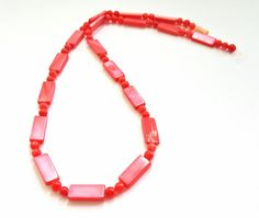 16 Inch Strand of 16 Inch Strand of Round and Rectangular Red Mother of Pearl Beads.  16 X 14mm and 4mm Beads.  59 Pretty…
