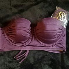 Bikini Top - VS The Scandalous Bandeau This is a Victoria's Secret bikini top. The style is The Scandalous Bandeau, the color is Eggplant, and the size is 34A. It's a very rich, deep, dark, purple. It's strapless but comes with straps that can be attached/removed. Very cute and sexy! It's original price is $59 so now it's over $20 off! :) Victoria's Secret Swim Bikinis