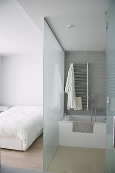 Desperate for an en suite but haven't got space . Why not have an open bathroom with frosted glass partition, retaining the feeling of open space & light, whilst gaining that extra bathroom. Open Bathroom, Loft Bathroom, Glass Bathroom, Bathroom Marble, Bathroom Plumbing, Bathroom Shelves, Bathroom Organization, Bad Inspiration, Bathroom Inspiration