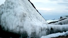 Ice covered rock off the shore of Lake Superior in Duluth, Minnesota. #AuthenticDuluth #VisitDuluth