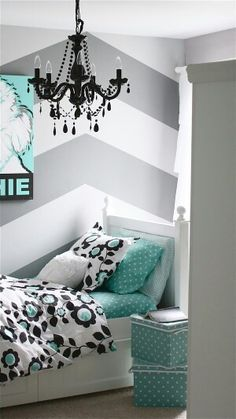 Love this comforter....with a diamond patterned accent wall instead of chevron. Love the black chandelier too.