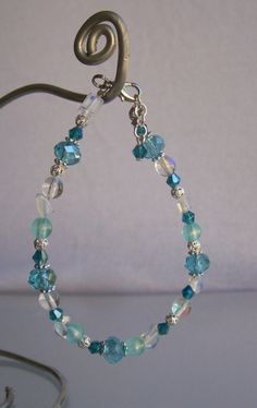 """This bracelet would make a great gift, or just a new accessory for yourself! Made with swarovski crystal beads, silver spacer beads, glass beads, plastic beads, and swarovski rondelle spacer beads. Measures 7.5"""" in length and made with a lobster clasp. Buy it here: https://www.etsy.com/listing/163420902/turquoise-beaded-bracelet?ref=shop_home_active"""