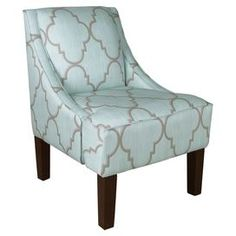 """The perfect accent for your living room or den decor, this chic upholstered accent chair showcases a lovely quatrefoil motif and a pine wood frame. Handcrafted in the USA.    Product: ChairConstruction Material: Pine wood, polyester and polyurethaneColor: Spring breeze mineralFeatures: Swoop armsHandcrafted in the USADimensions: 34"""" H x 24"""" W x 28"""" D"""